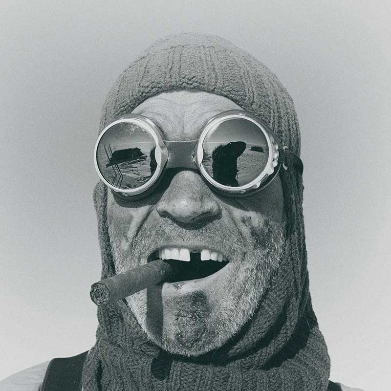 Lieutenant Colonel Henry Worsley, OBE, British explorer and British Army officer smoking a cigar wearing goggles.