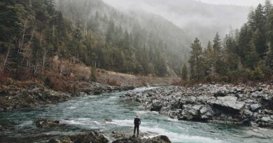 man by river in cloudy valley nature quotes