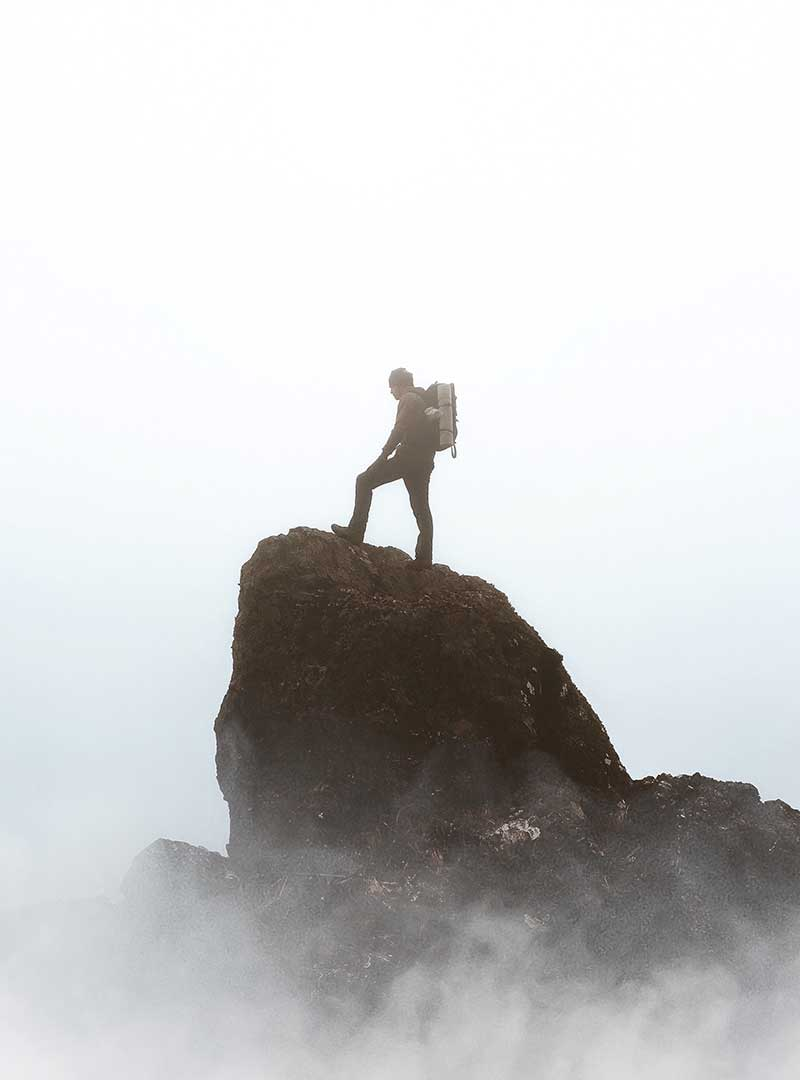 Male hiker on mountain top travelling quotes