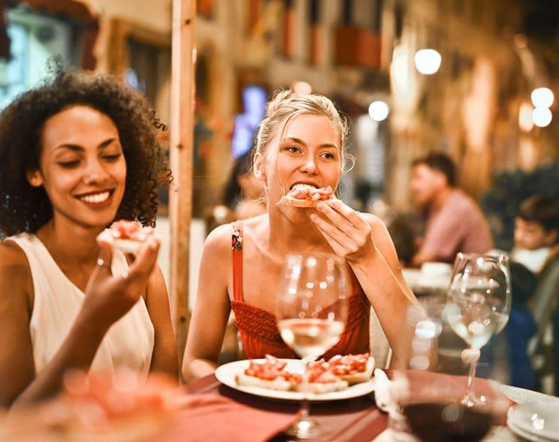 Adults eating vegan foods