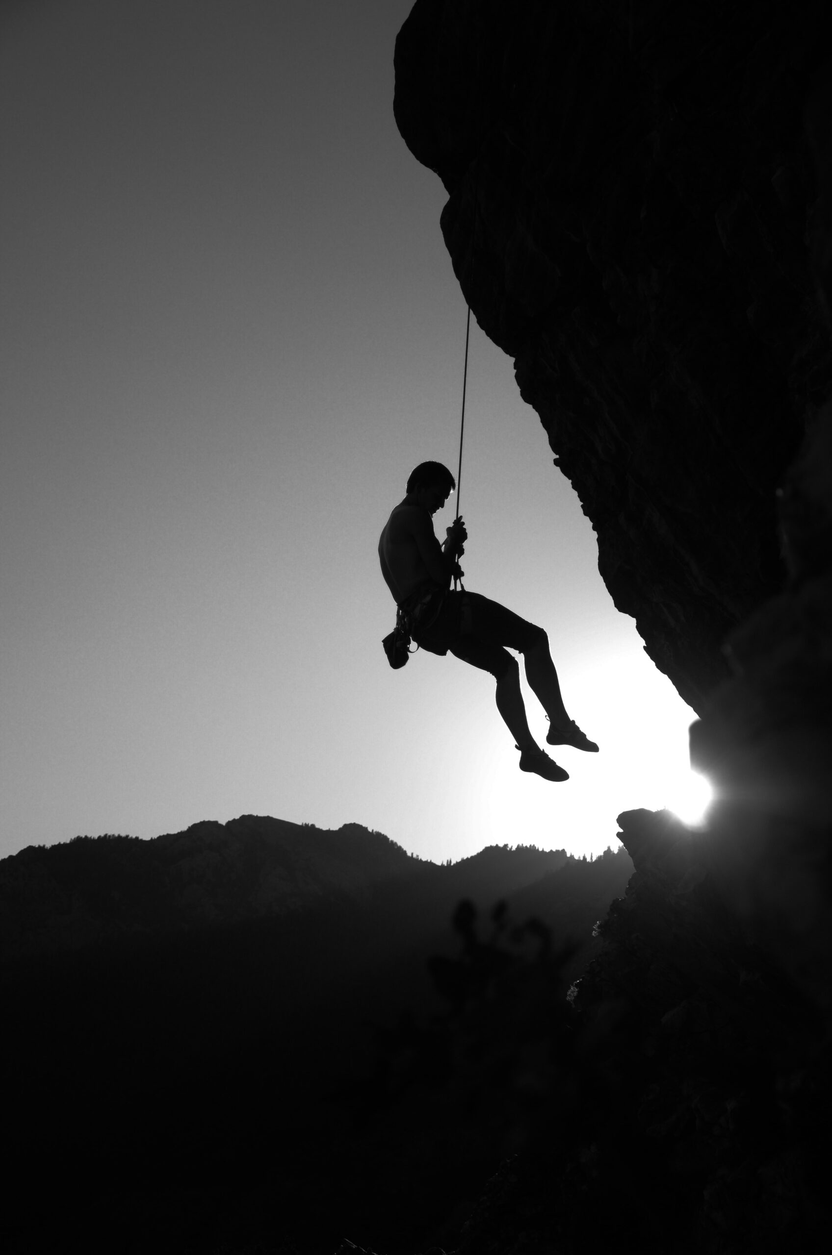 Climbing Quotes with male athlete on cliff