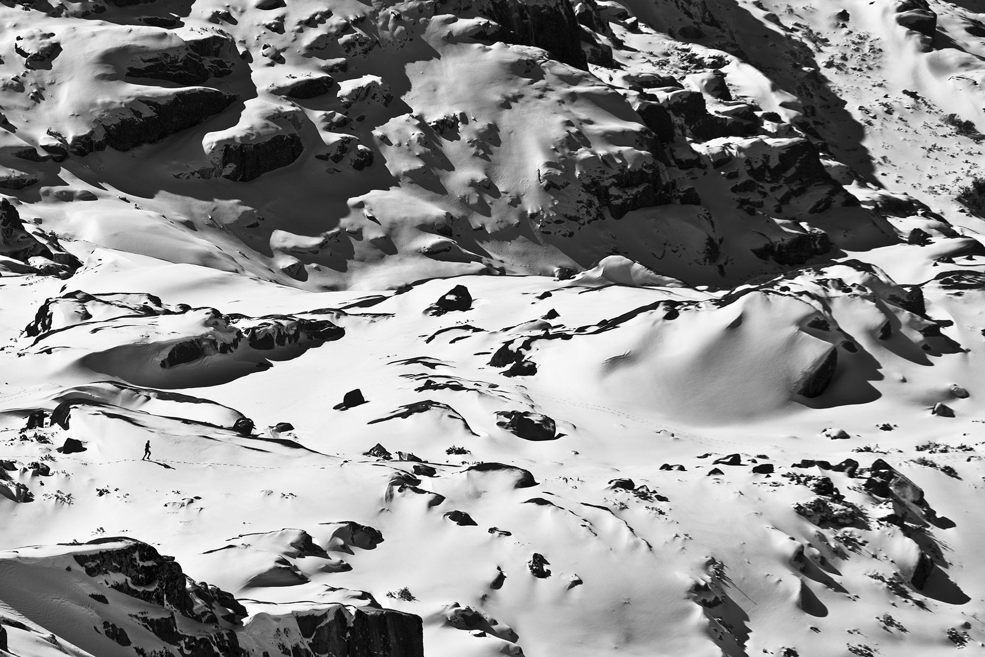 walking figure in snowy landscape