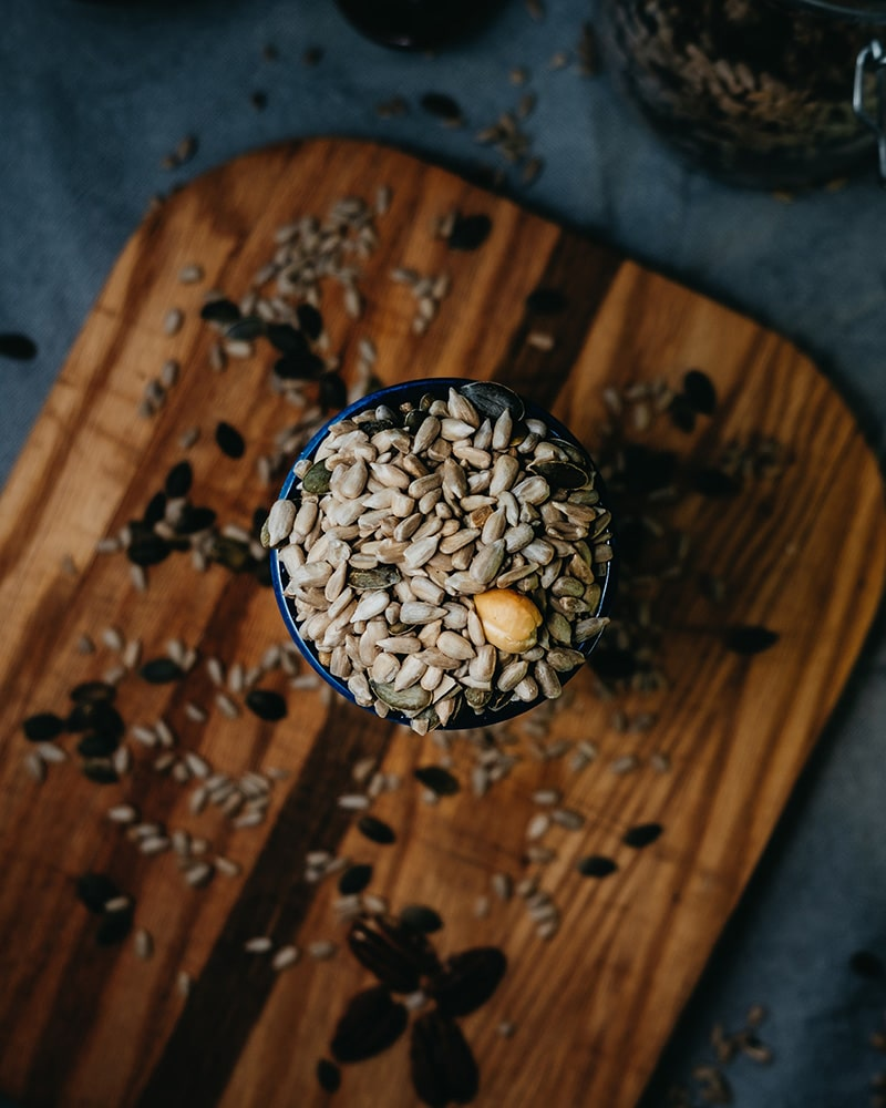 nuts and seeds on wooden board