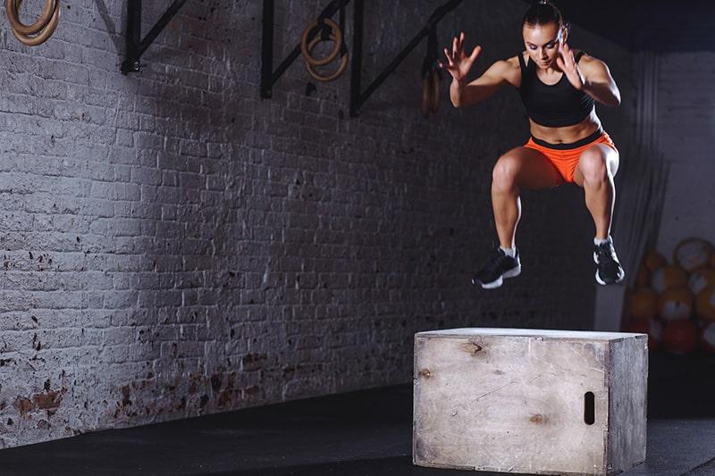 woman doing box jumps