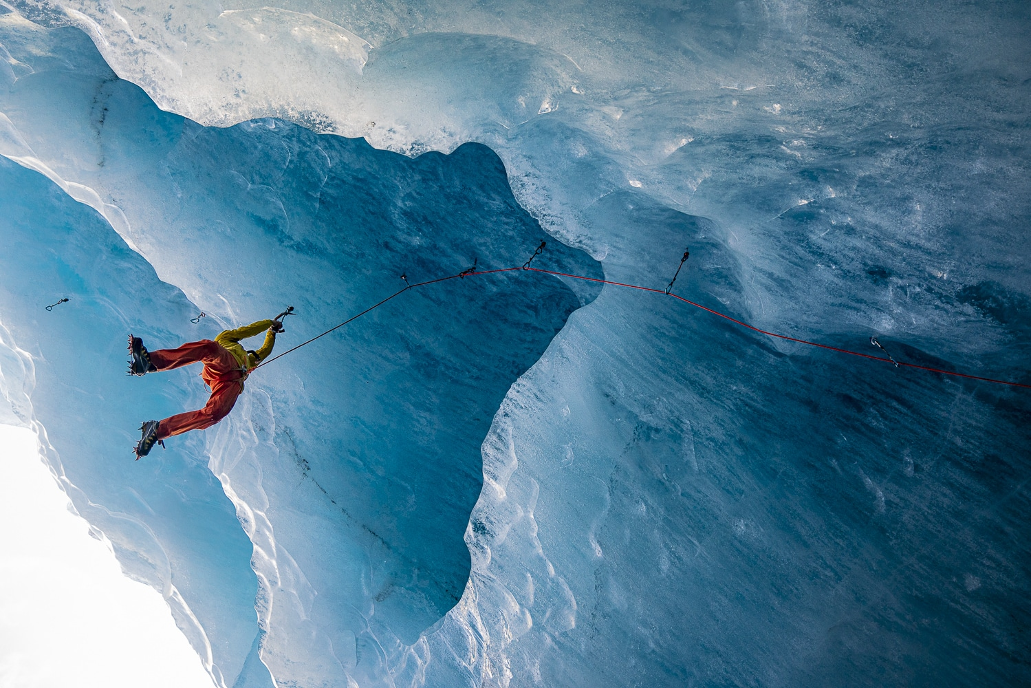 Jeff Mercier climbing in an ice cave.