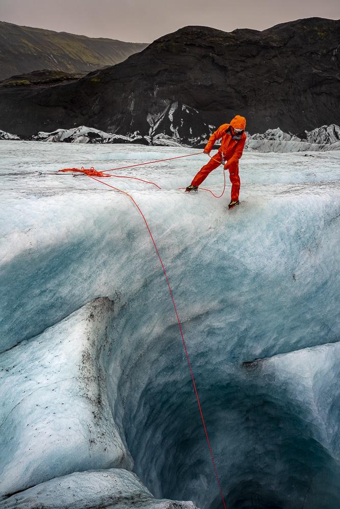 Jeff Mercier descends into the ice cave.