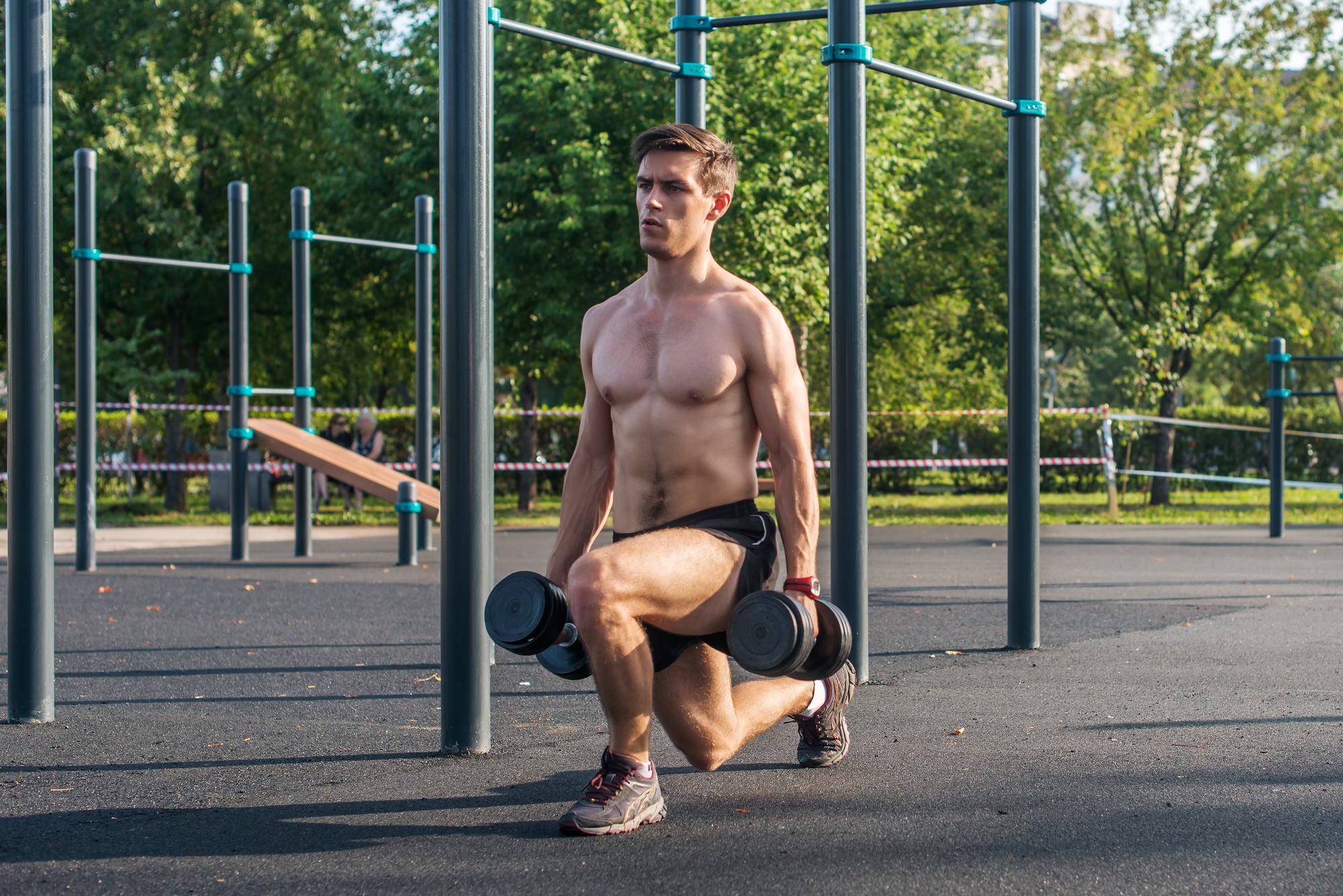 Man performing lunges in the park