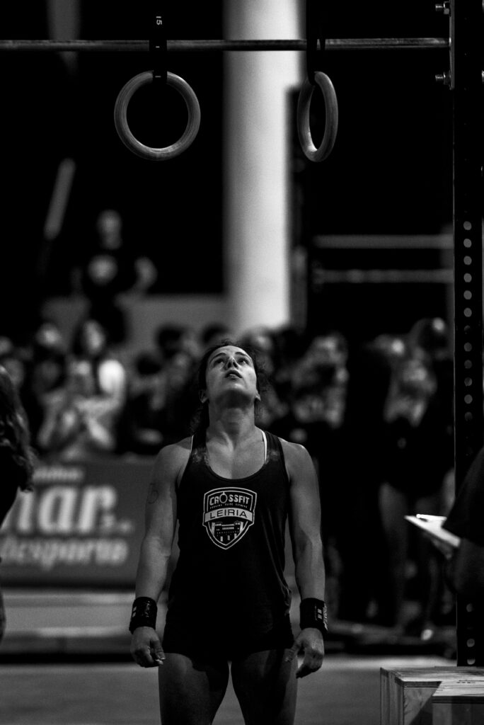Woman doing muscle ups.