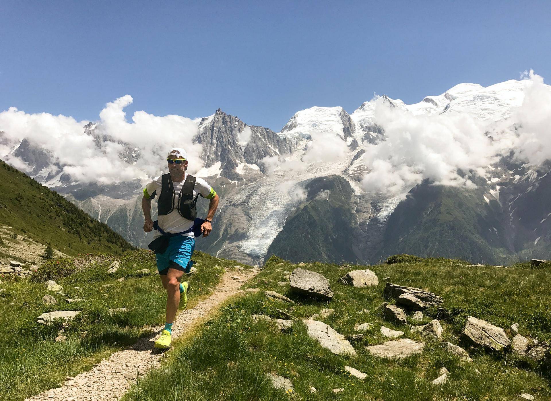 Runner on mountain top