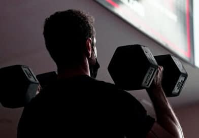 Dumbbell Thruster performed by man