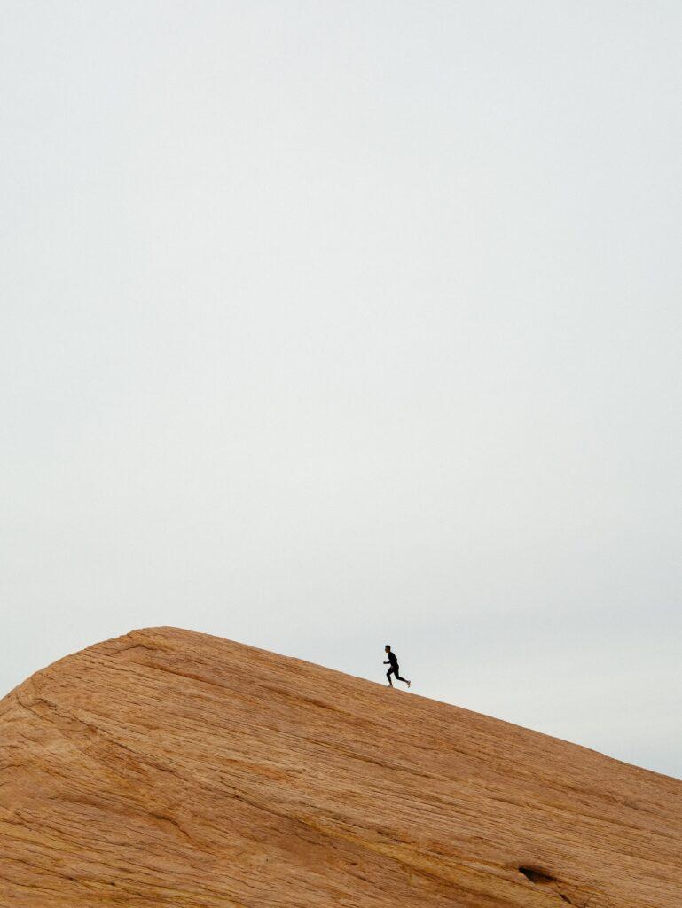 Runner on sand dune