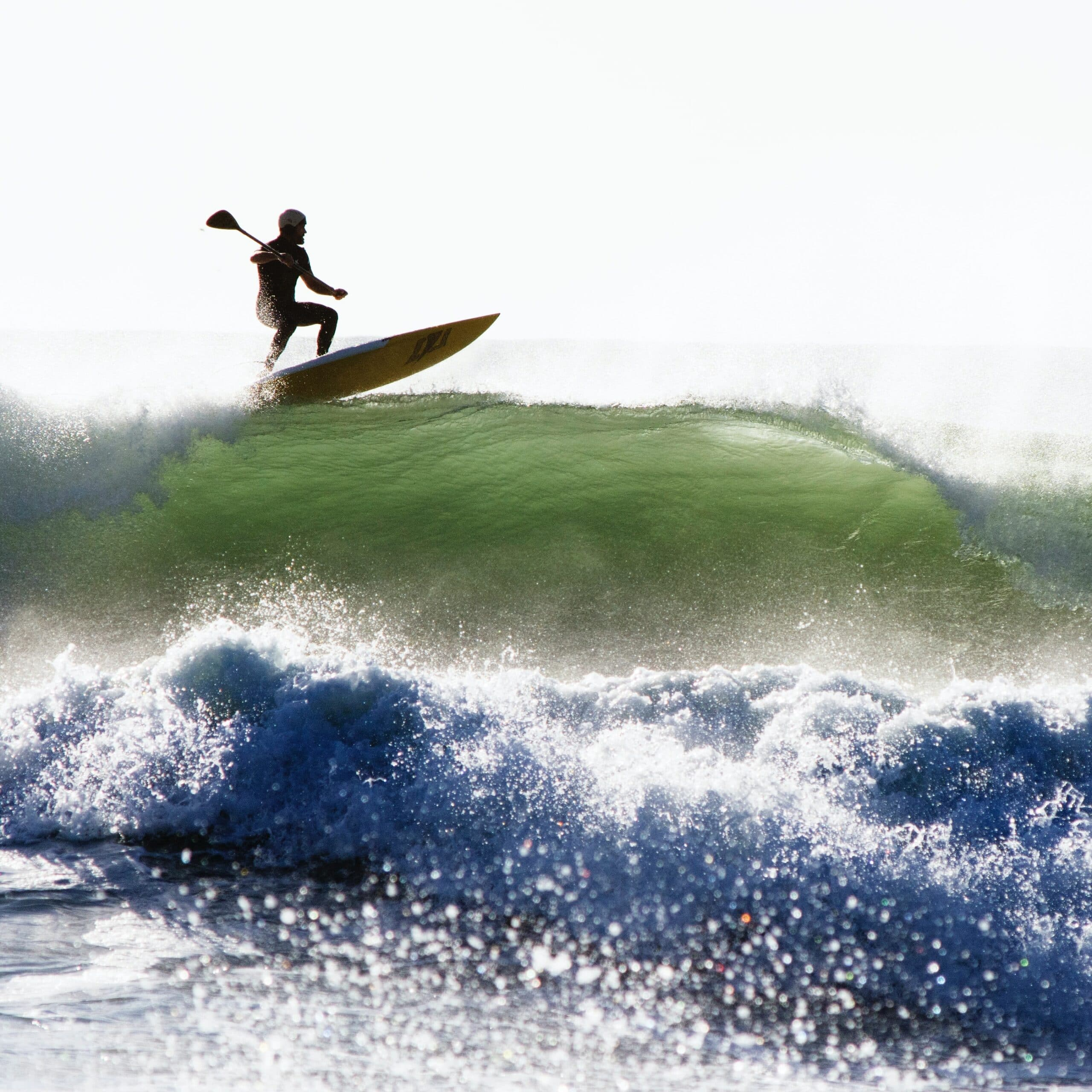 Man riding wave on SUP