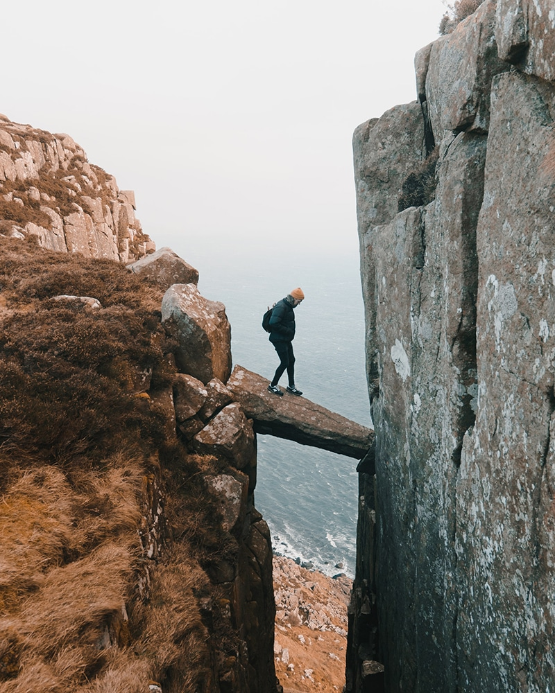 Man outdoors on a Rock near the sea