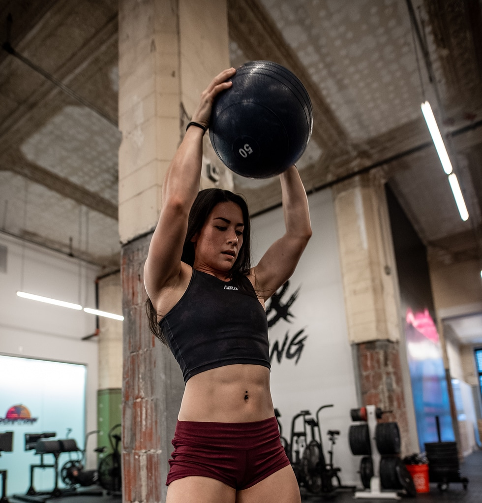 Woman performing the slam ball exercise