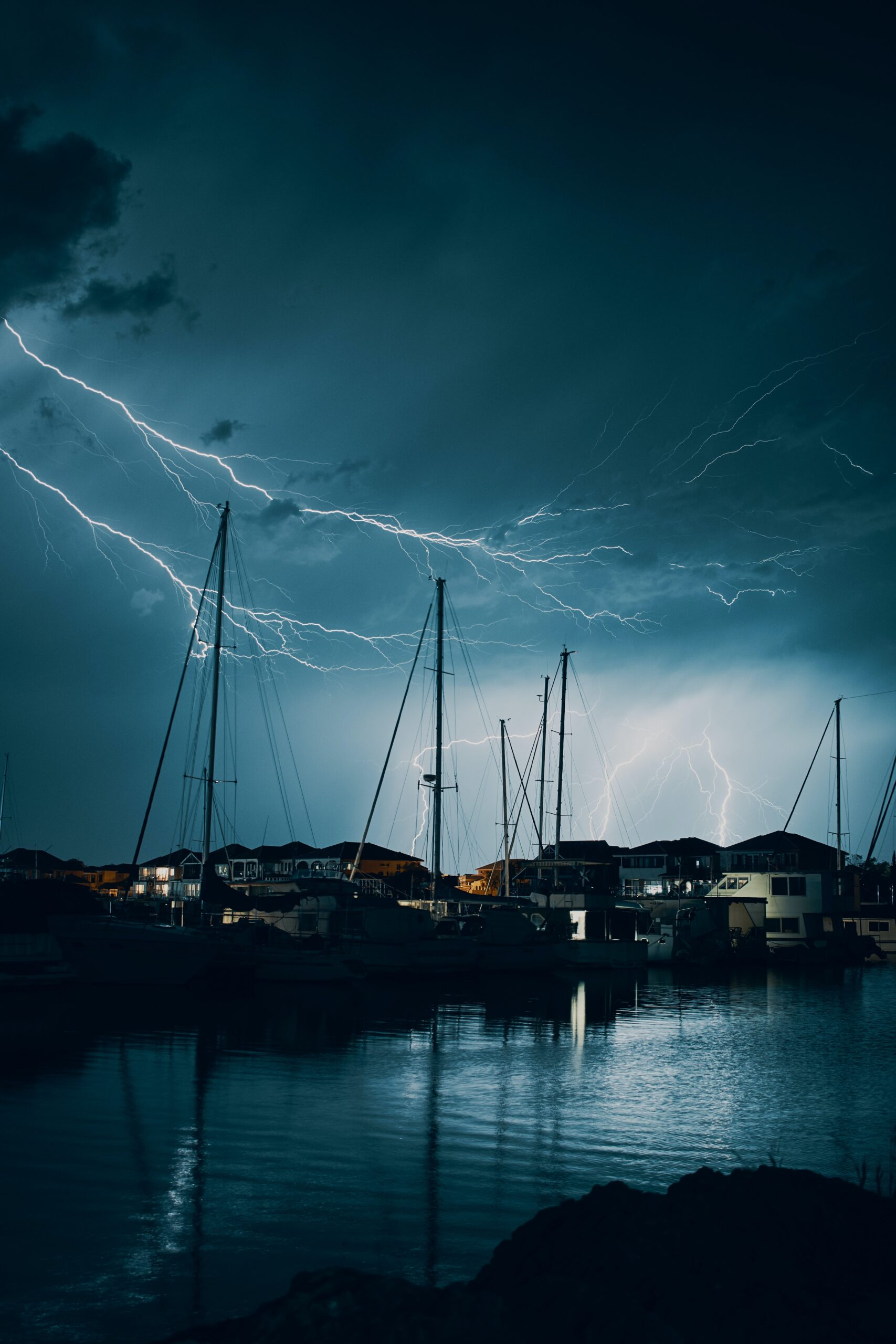 boats on lake with storm