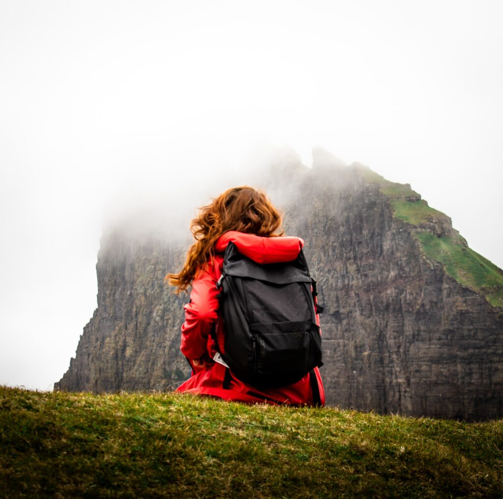 Woman in red coat hiking