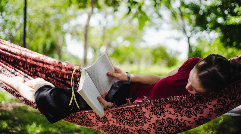 reading adventure books in a hammock