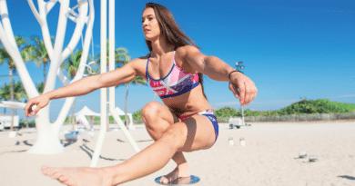 Pistol Squat on Beach with female athlete