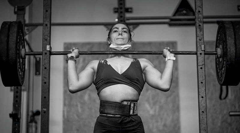 woman performing strict press